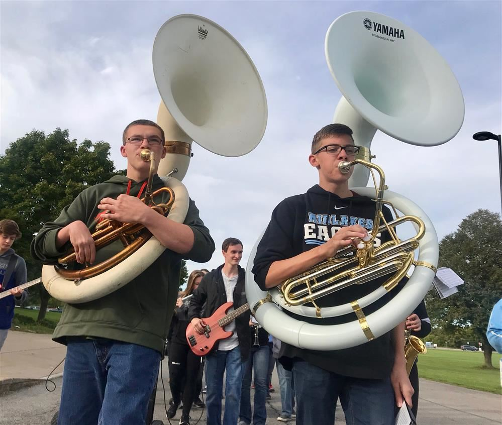 The Midlakes High School Band performs during the Homecoming Parade.