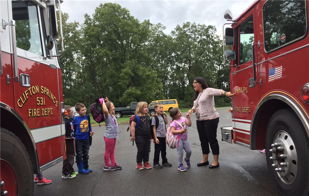 Photo of students getting a chance to see fire trucks from Phelps and Clifton Springs on school campus.