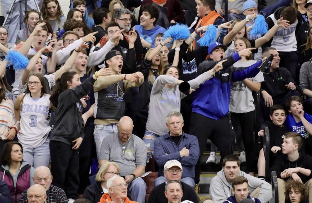 photo of students cheering on the screaming eagles basketball team